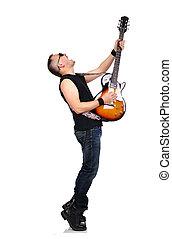 rocker is playing electrical guitar