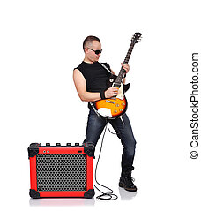 rocker with electrical guitar and guitar combo