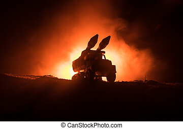 Rocket launch with fire clouds. Battle scene with rocket Missiles with Warhead Aimed at Gloomy Sky at night. Rocket vehicle on War Backgound