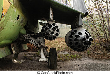 Rocket launcher under the wing of fighter aircraft. Focus on rocket pod