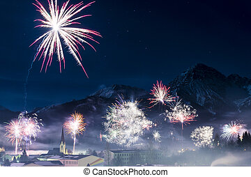 rockets firework at new years day in front of snowy ...