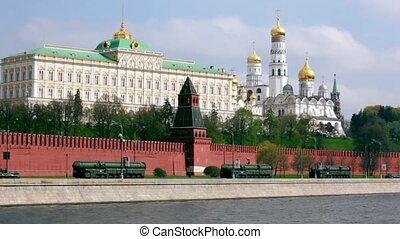 Rockets motorcade ride by quay of Moscow Kremlin, red brick...
