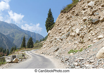 rockfall on the road in the mountains