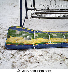 chair cover abandoned on the snow