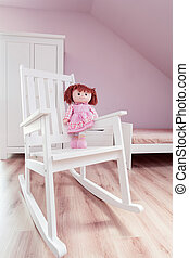 Rocking chair in girl's room
