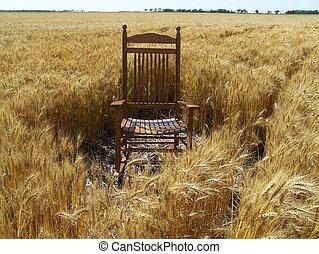 Rocking chair in wheat field