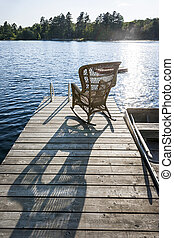 Rocking chair on small lake dock