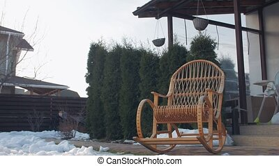 Rocking chair yard winter snow push out backward camera movement