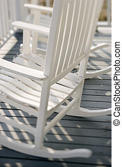 Rocking chairs on porch.