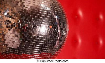 rocking mirror disco ball in left side of frame