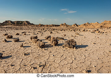 Rocks Across Cracked Dirt Surface