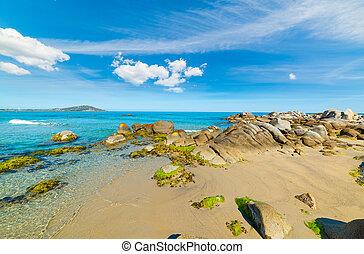 Rocks and blue sea in Orri beach in the springtime