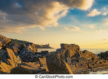 Rocks and buildings on the sea on sunset. Livorno, Tuscany...