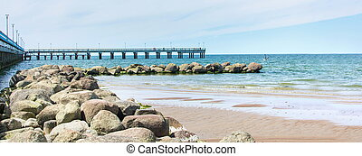 Rocks and dock of Palanga beach in Lithuania