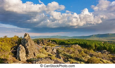 Rocks and mountain range time lapse - Time-lapse with...