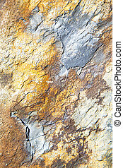 rocks and red orange gneiss in the wall of