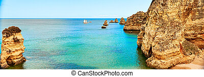 Rocks and sandy beach in Portugal, Atlantic coast, Algarve.