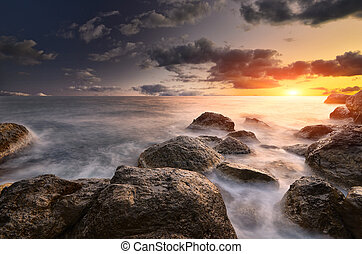 Composition of nature. - Rocks and sea. Dramatic scene. ...