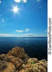 Rocks and sea sun