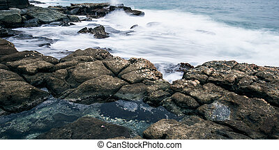 Rocks and waves at Point Cartwright beach in the afternoon....
