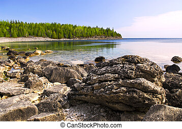 Rocks at shore of Georgian Bay - Rocks in clear water of...