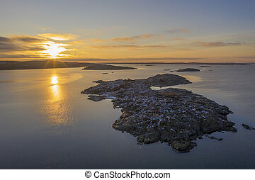 Rocks at the sea in sunset drone photo