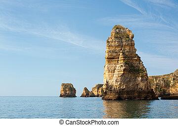 Rocks bathing in the Atlantic ocean in Lagos, Portugal