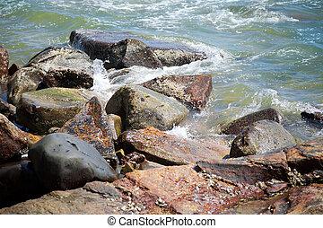 Rocks by ocean water