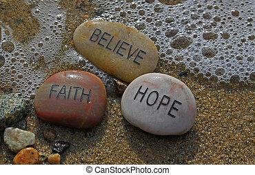 faith, hope, believe rocks in the water.