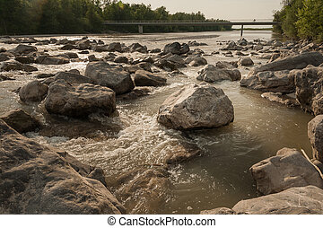 Rocks in a river Bregenzer Ache in summer