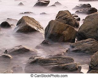 Rocks in faded sea