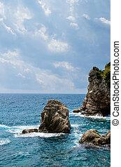 rocks in the blue sea