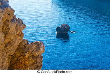 Rocks in the blue sea in Sardinia