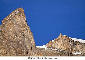 Rocks in the blue sky