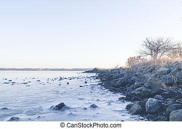 Rocks in the frozen sea on a coastline