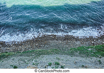 Rocks in the ocean, viewed from above