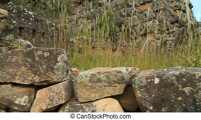 Rocks Layered on Wall - Handheld, panning, close up shot of...