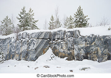 Rocks of an ancient marble quarry. Ruskeala, Karelia