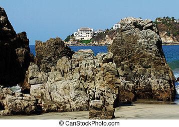 Rocks on beach in Puerto Escondido, Mexico