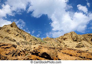 Rocks on blue sky background