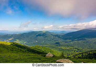 rocks on grassy hillside of Carpathian mountains - landscape...