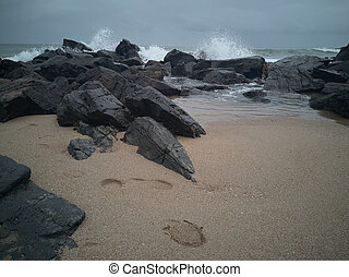 Rocks on the beach after the storm