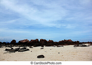 Rocks on the beach in the sea