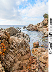 Rocks on the coast of Lloret de Mar in a beautiful summer day, Costa Brava, Catalonia, Spain