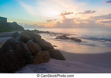 Rocks on the Sand at Sunset