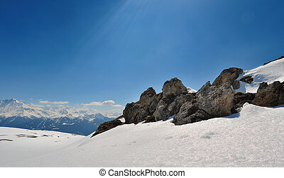 rocks on the snow in mountain