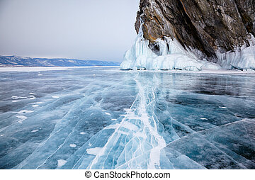 Rocks on winter Baikal lake - Rocks frozen into the ice of...