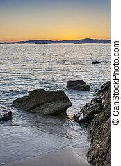 Rocks, sea and sand on the beach