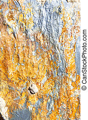 rocks stone orange gneiss in the wall of morocco