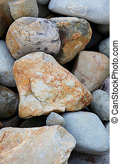 Texture of large rocks, brown and gray abstract background